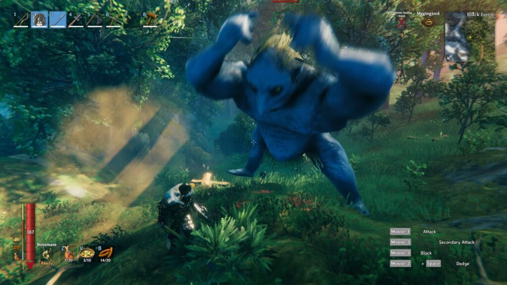 A player parries a large attacking monster